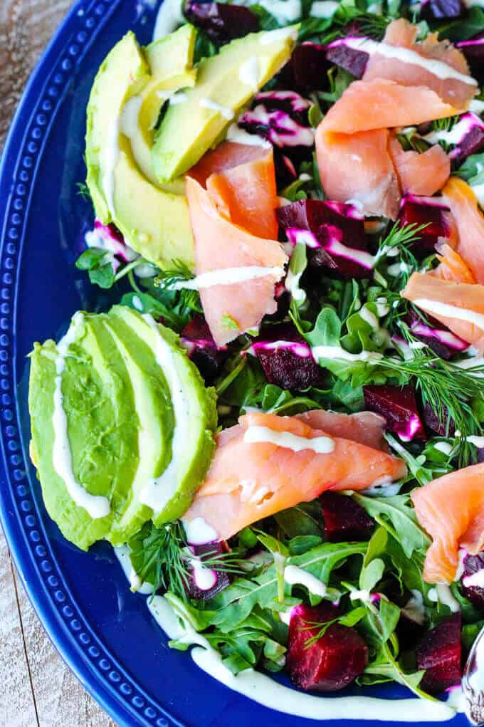 Smoked Salmon and Roasted Beets Salad with a Goat Cheese Dressing with avocado. vertical close up