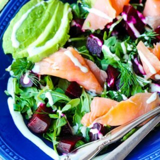 Smoked Salmon and Roasted Beets Salad with a Goat Cheese Dressing with avocado, vertical shot