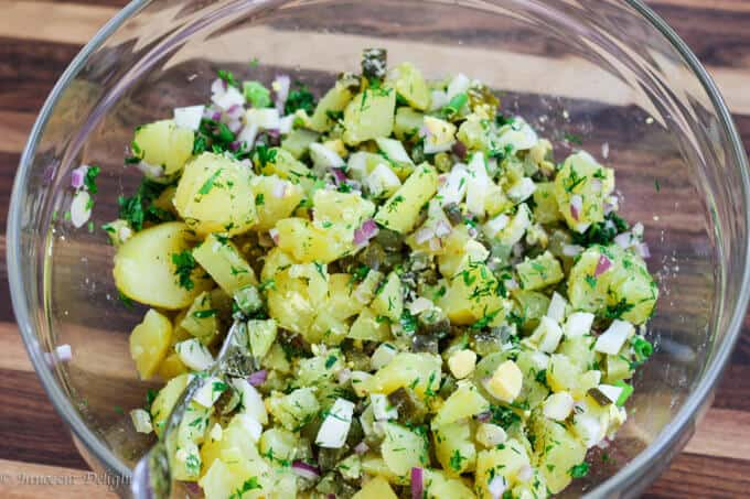 Potato Salad with Eggs and Pickles is super easy to make and it tastes incredible. The combination of eggs, pickles and an assortment of herbs make for a decadent, yet simple and unique dish.