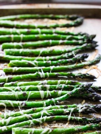 Roasted asparagus with parmesan cheese on a sheet pan