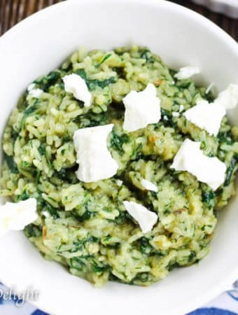 Greek Rice with Spinach served in a bowl with Feta Cheese
