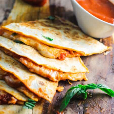 Margarita Pizza Quesadillas combine two of the most popular Italian and Mexican dishes - pizza and quesadillas. Listen, if 1 is good...2 is better!
