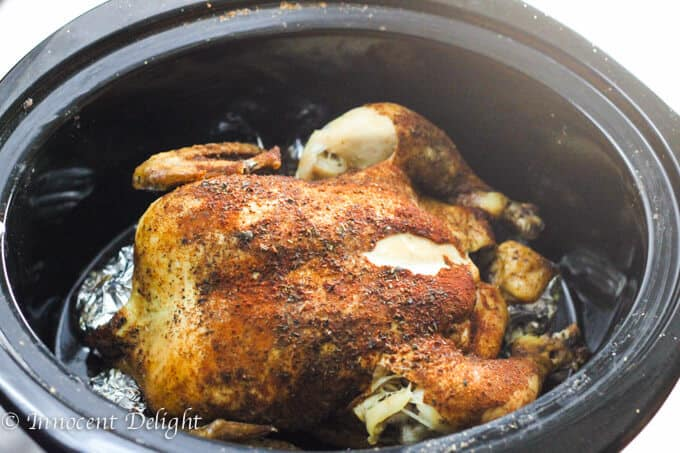 Only 5 minutes of preparation is needed for this  amazing Slow Cooker Whole Roasted Chicken. Spice it up. Set it and forget it. The most juicy chicken you could ever imagine.