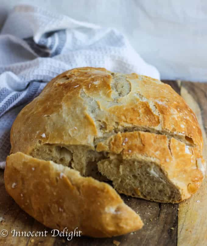 Partially sliced Homemade Dutch Oven Crusty Bread