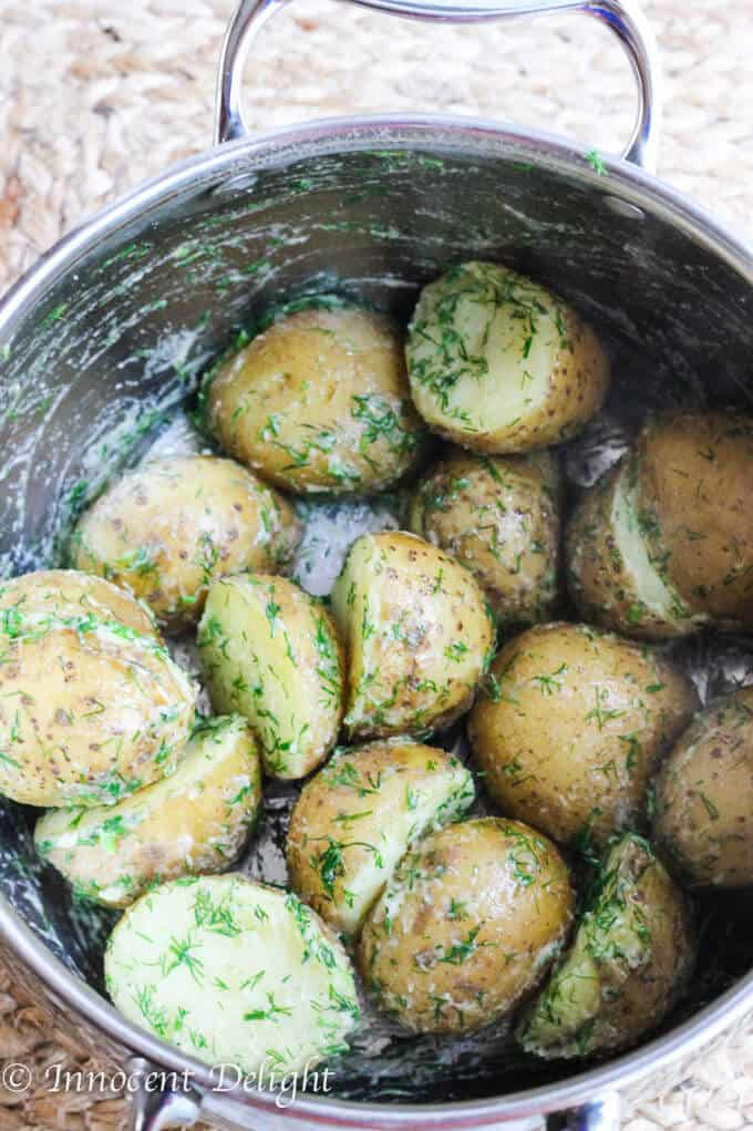 New Dill Potatoes with Scallion Cream Sauce - Polish summer staple side dish. This type of potatoes are the creamiest out there and they are only available for the short period of time. Hurry up, get some on your local farmer's market and follow this recipe to try the best potatoes you have ever tasted.
