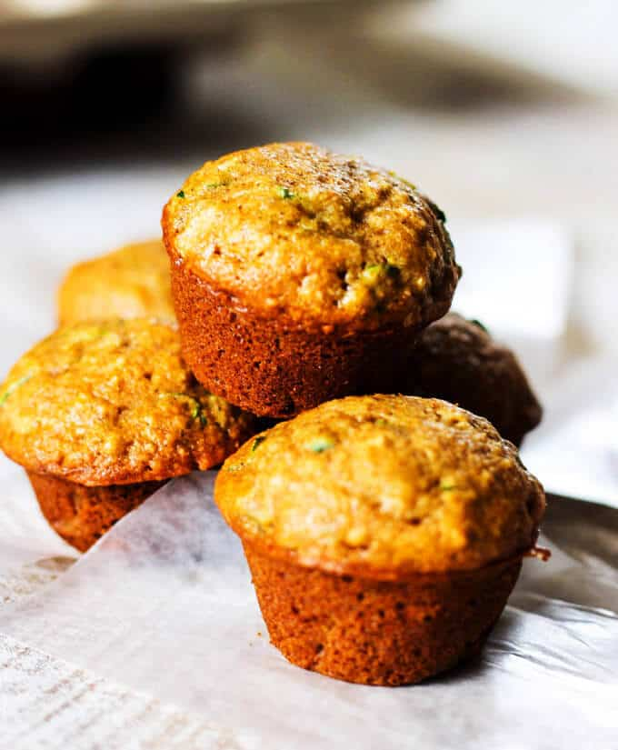 Healthy Mini Zucchini Muffins - these super easy, mini sized, one bite, whole wheat healthy muffins are a treat that every kid would love.