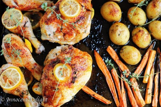 One Pan Herbed Lemon Chicken with Veggies Recipe - quick and easy dinner that requires minimal preparation that takes 5 minutes. The oven does the job for you.