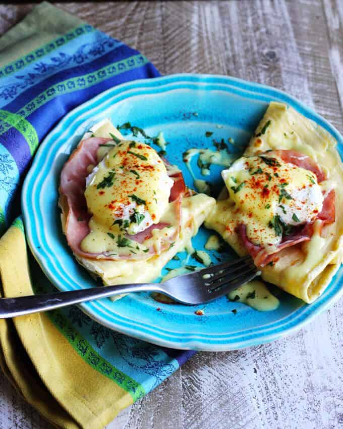 Easy Crepes Eggs Benedict Recipe - super easy twist on this classic American breakfast. Next time you feel like Eggs Benedict, try to pair them with classic French crepes. We couldn't get enough.
