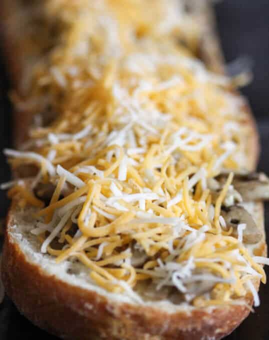 Open Face Mushroom and Cheese Sandwich - famous Polish street food called Zapiekanka or Zapiekanki in plural. You can find them on every corner in Poland.