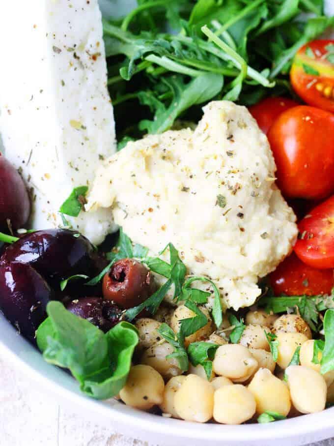 Mediterranean Hummus Bowl with Kalamata Olives Feta and Tomateos