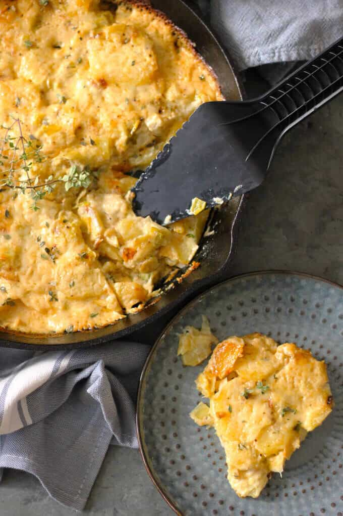 Potato Leek Casserole - ultimate comfort food side dish that resembles in taste famous Potato Leek Soup; topped with cream and Gruyer Cheese, rich, decadent, elegant and delicious casserole- Innocent Delight