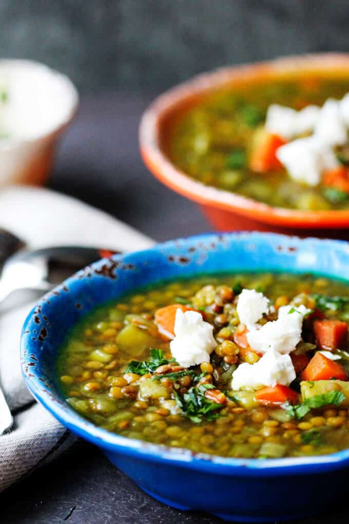 This soup is called Fakes and is a staple in Greek cuisine. It needs to be served with olive oil and red wine vinegar. Top this Greek Lentil Soup with Feta.