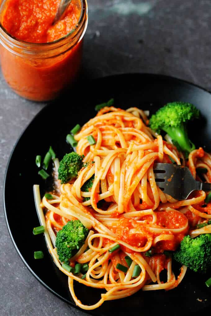 Linguine with Broccoli and Romesco Sauce is an amazing pasta dish with a uniquely Spanish twist. Freshly cooked linguine is tossed with broccoli and a sauce made of roasted red peppers, tomatoes, onions and toasted almonds. Simply delicious.