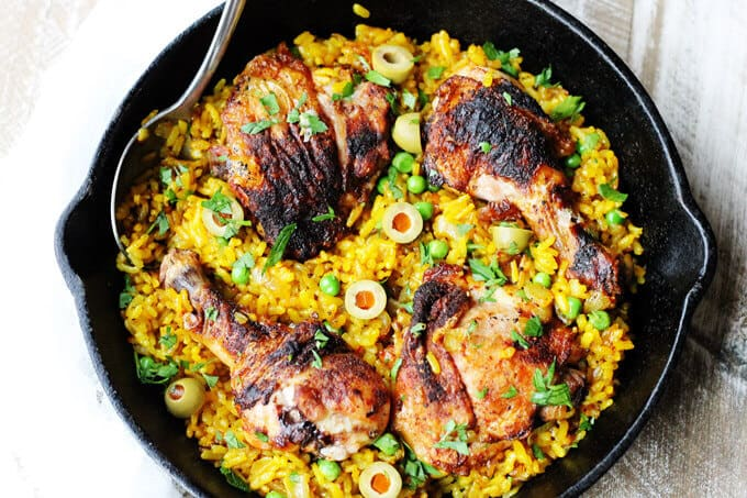 One pot chicken saffron rice with saffron, peas, olives and Piementon is an easy weeknight meal that requires minimal work.