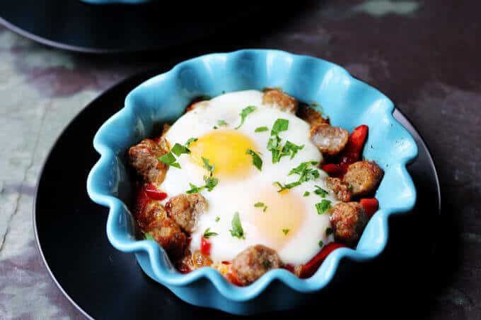 Oven Baked Eggs with Sausage, Peppers & Onions is super easy to make yet absolutely delicious. It's also elegant and perfect for special occasions like Mother's Day.