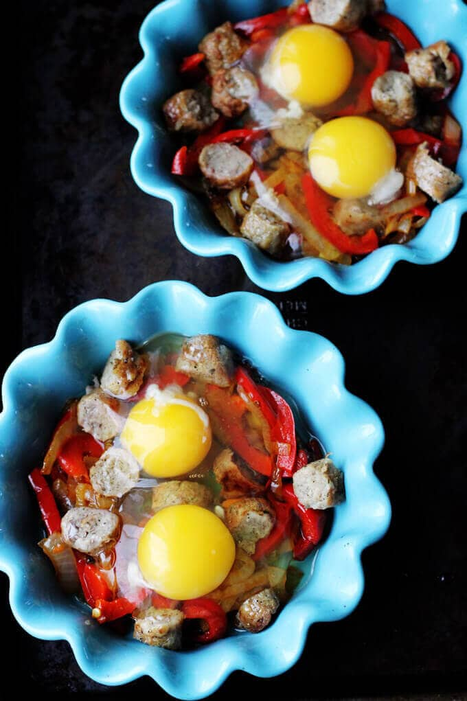 Oven Baked Eggs with Sausage, Peppers & Onions are super easy to make yet absolutely delicious. They're also elegant and perfect for special occasions, like Mother's Day.