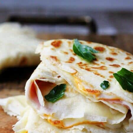 Ham and Cheese Crepes are one of the most famous French street foods. Simple batter from flour, milk, eggs and butter can make amazing perfect crepes. Fill them up with sliced ham and melting cheese and you can feel like on the corner of the French street.
