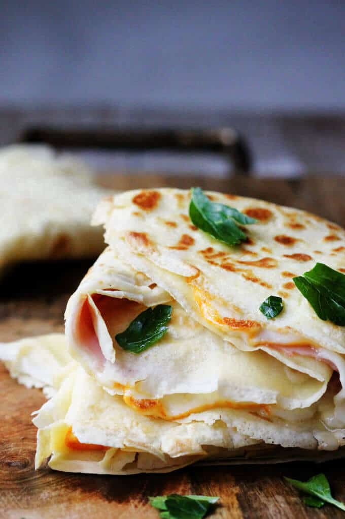 Folded Ham and Cheese Crepes on a board