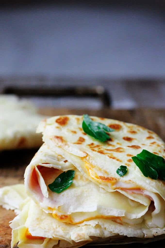 Ham and Cheese Crepes are one of the most famous French street foods. A simple batter of flour, milk, eggs and butter, combine to make perfect crepes. Stuff them up with sliced ham and melted cheese, and you'll be immediately transported of a French street corner.