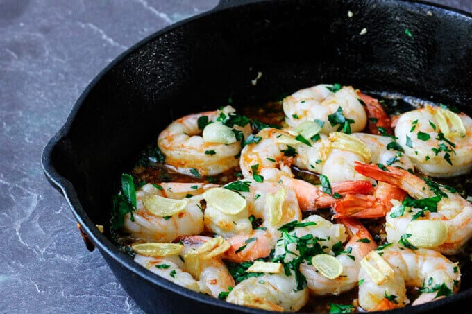 Spanish Style Garlic Shrimp is cooked in olive oil with lots of garlic, dry chilies or Spanish smoked paprika and brandy or sherry wine. It's absolutely outstanding.