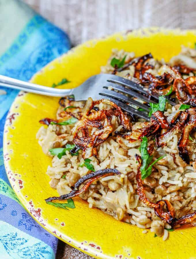 Lebanese Mujadara Recipe combines lentils with rice for a perfect protein meal. Seasoned with Middle Eastern flavors and topped with crispy fried onions makes for a truly irresistible dish.