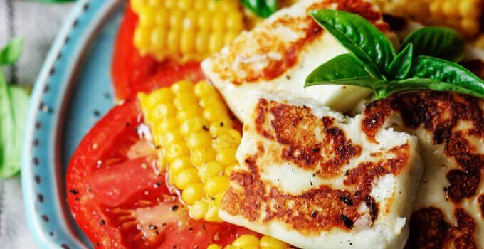 Fried Halumi Cheese with Corn and Tomatoes is an amazing summer appetizer. This humble cheese from Cyprus will make an unforgettable experience.
