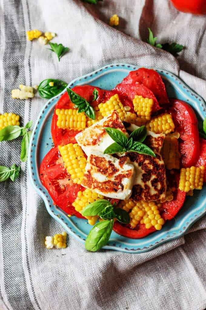Fried Halloumi Cheese with Corn and Tomatoes is an amazing summer appetizer. This humble cheese from Cyprus will make for an unforgettable experience.