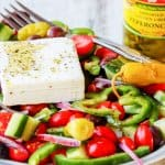 Horiatiki Salad with Golden Greek Peperoncini coHoriatiki Salad with Golden Greek Peperoncini combines the freshest ingredients of seasonal tomatoes, cucumbers, green peppers, red onions, tangy kalamata olives and creamy feta with mildly piquant, fruity flavor Mezzetta Peperoncini. #DontForgettaMezzetta #Mezzetta #Ad