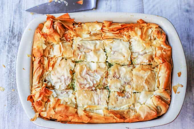 Kolokithopita, or Greek Zucchini Pie, is a perfect comfort food for the end of the Summer. The dish is a simple combination of zucchini, onions, herbs, eggs & feta, wrapped in a flaky phyllo dough, which makes for an awesome, light vegetarian meal.