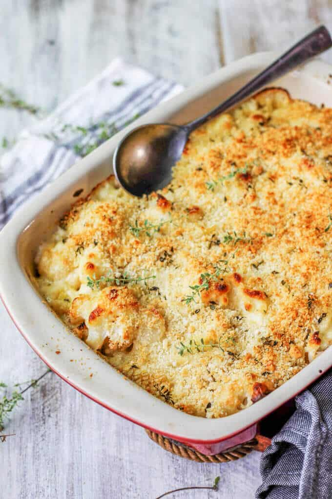 Cauliflower Pasta Bake with Brie and Fontina in a casserole with spoon
