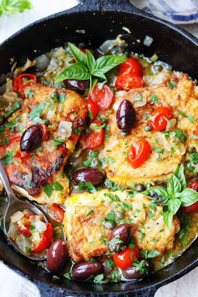 Pan Fried Haddock Mediterranean Style with white wine, cherry tomatoes, kalamata olives and capers in a skillet