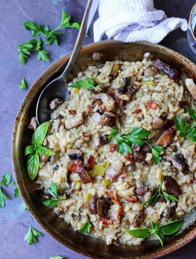 Wild Mushroom Risotto with Bacon and Leeks is exceptionally flavorful and delicious. Every bite brings a combination of different flavors and textures.