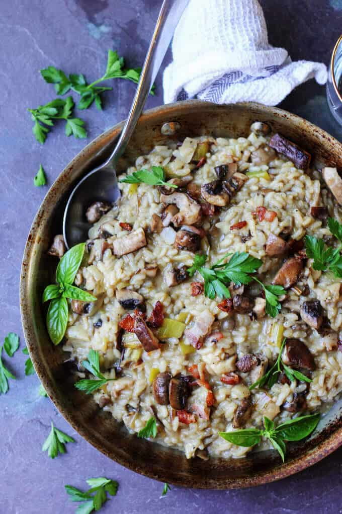 Wild Mushroom Risotto with Bacon and Leeks in a skillet with spoon