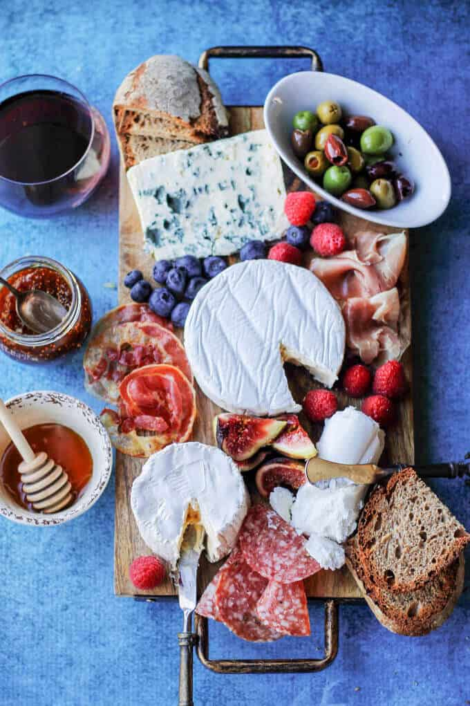 Building the Perfect French Cheese Board can be easier then one might think. This guideline for cheese and wine pairings will help to make any appetizer round super easy, and without losing elegance and sophistication. #ad #madeinfrance #madewithlove