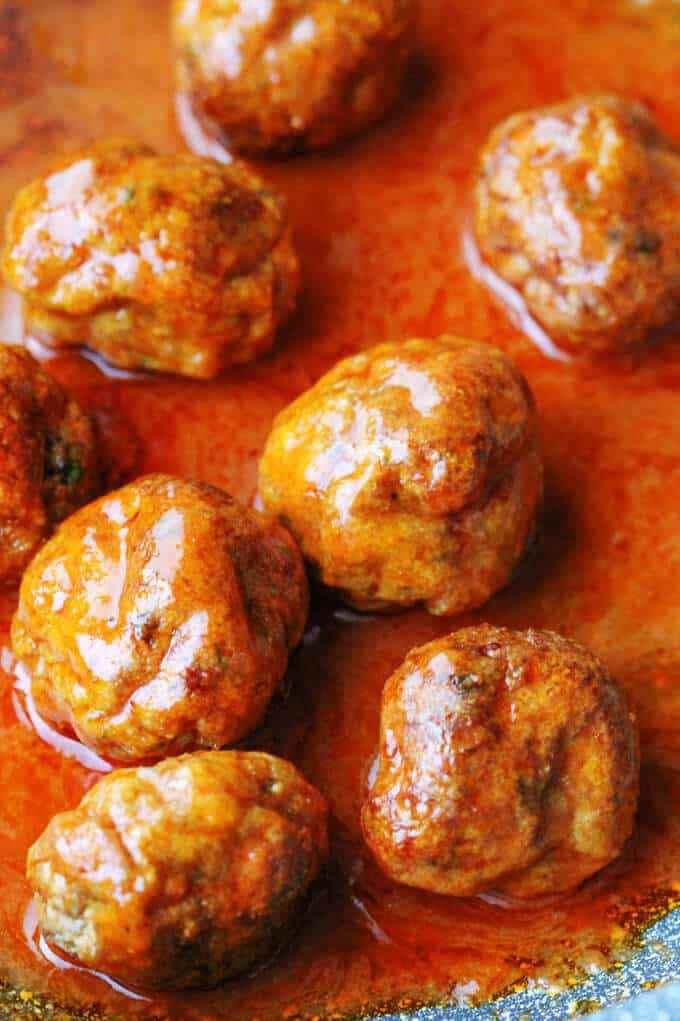 Buffalo Turkey Meatballs in a sauce on a pan