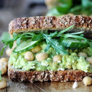 Smashed chickpea avocado feta sandwich, close up, horizontal