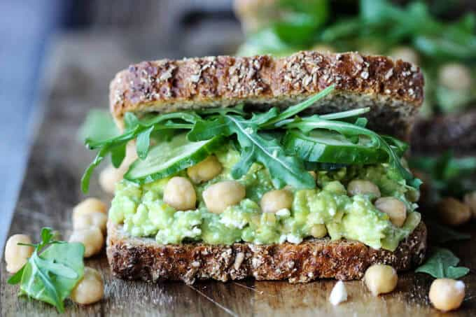 Smashed chickpea avocado feta sandwich, close up, horizontal