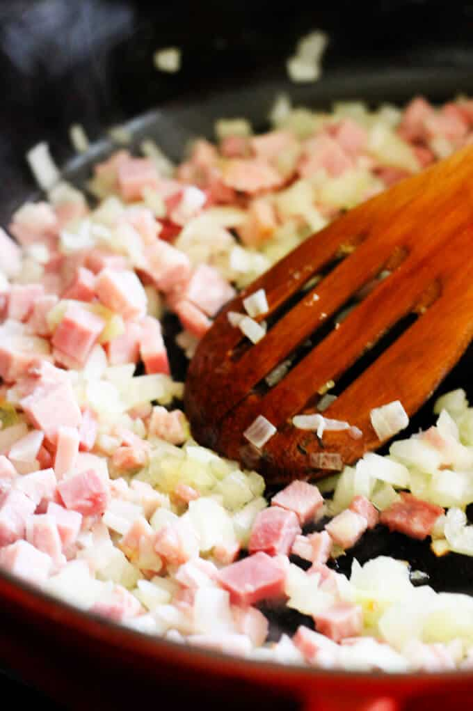 ham and onions sautéed on a pan
