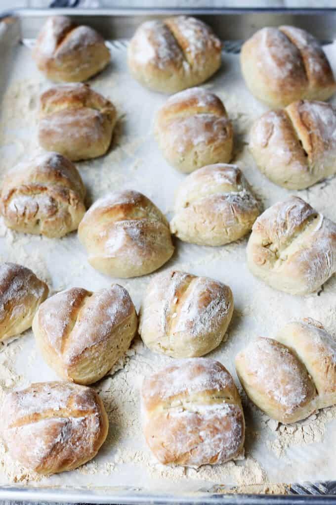 Baked breakfast rolls on a floured sheet pan