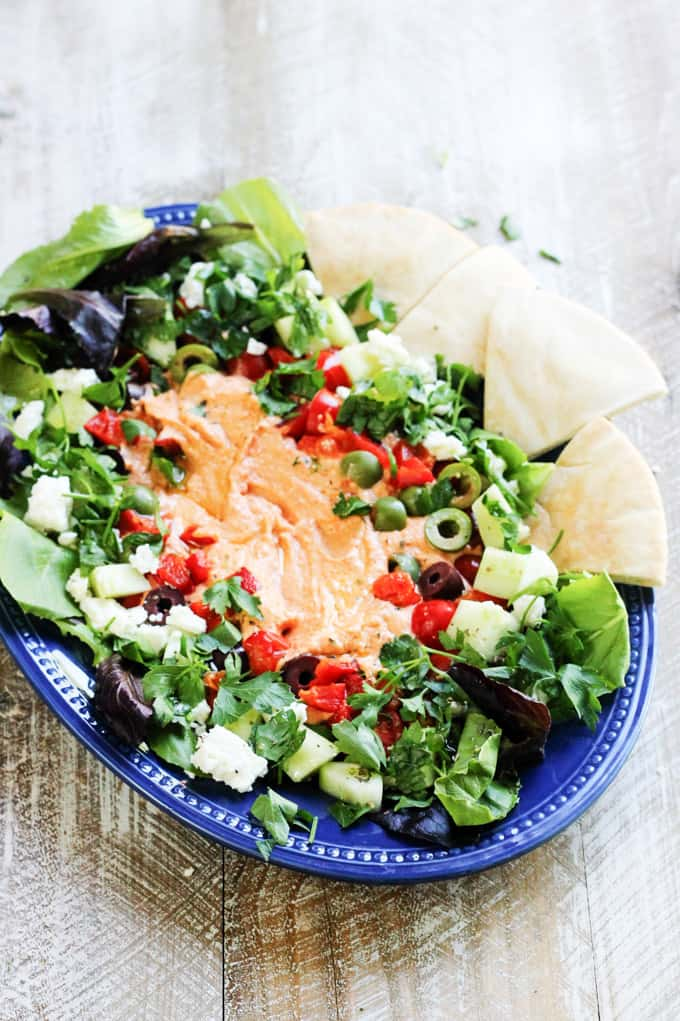 Mediterranean hummus platter on blue plate