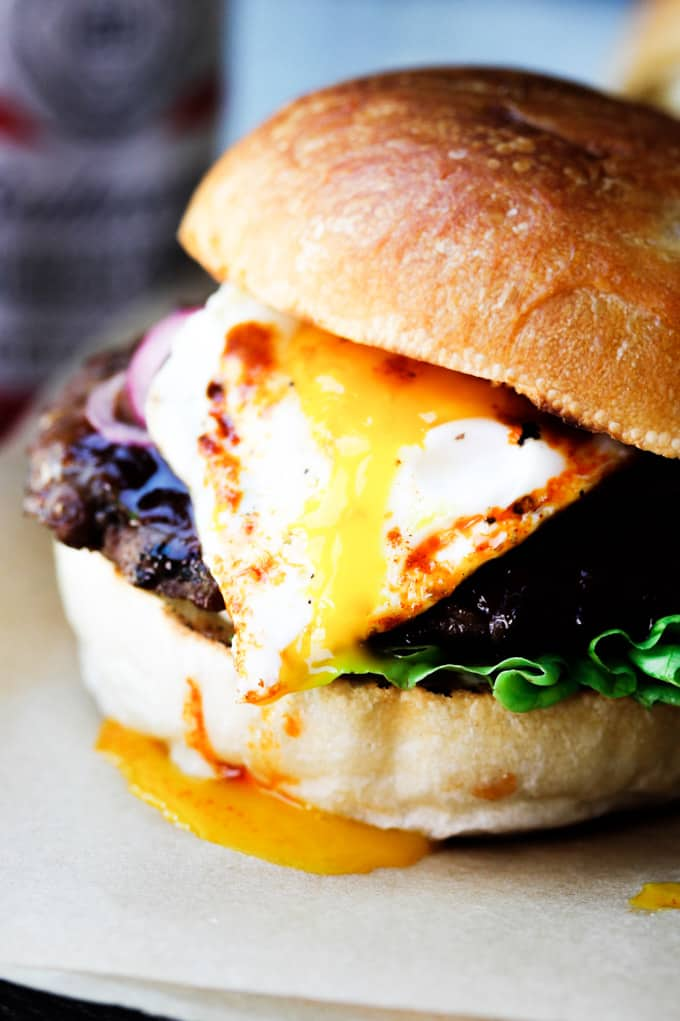 Smoky burger with runny egg yolk