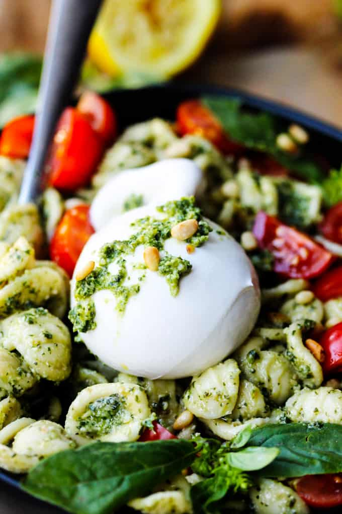 Burrata Cheese Bowl on a plate with pesto pasta and cheery tomatoes