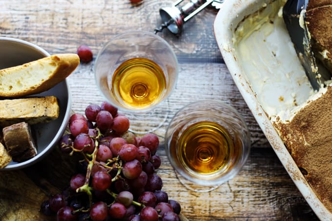Italian Dessert Wine Passito in glasses with grapes and desserts on a side