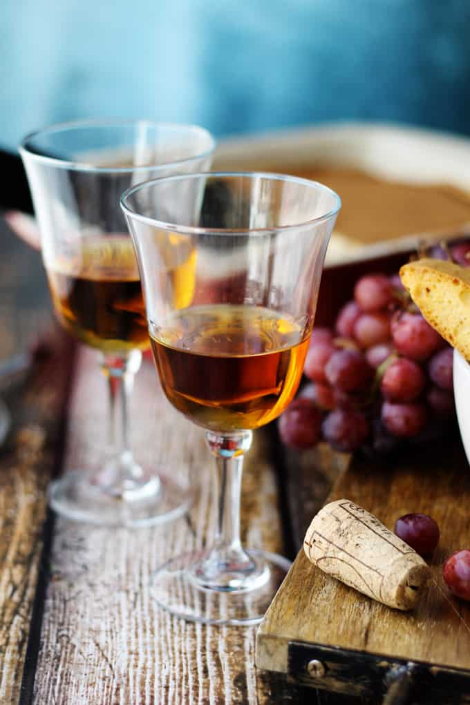 Italian Dessert Wine Vin Santo with grapes on a side