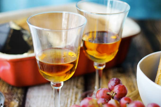 Italian Dessert wine Romandolo in glasses with desserts on a side