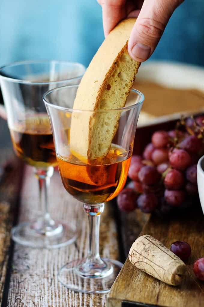 Dipping biscotti in Italian Dessert wine Vin Santo