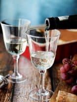 Pouring Italian Dessert Wine Moscato D'Asti into a wine glass