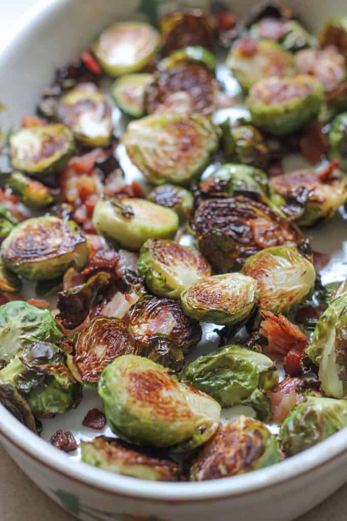 Roasted brussels sprouts with bacon in a baking dish