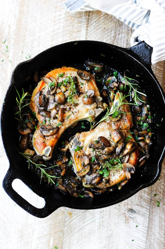pork chops with mushrooms in cast iron skillet
