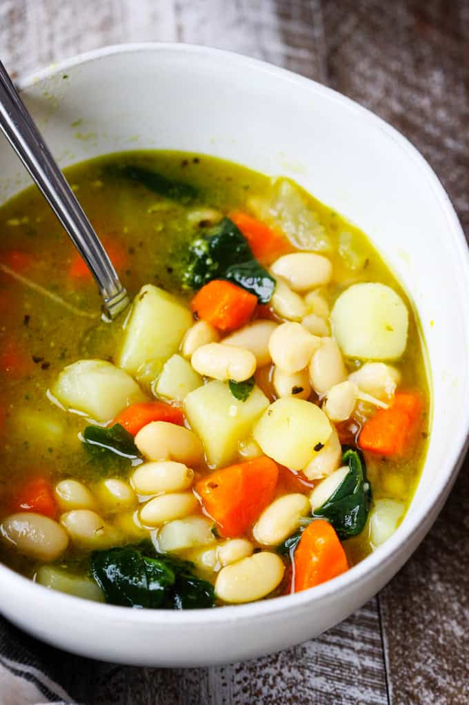 Instant Pot Bean Soup in a bowl with spoon